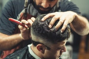how much can a UK barber earn